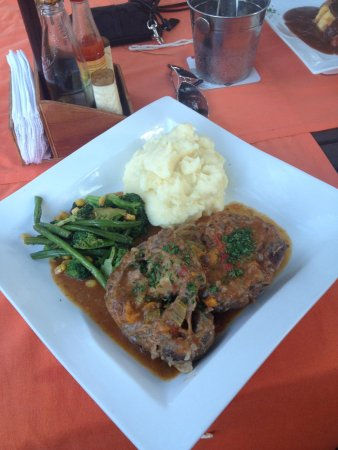 GouRmet Bistro: milanese osso buco......traditional italian...... beef on the bone slowly braised in a blended s