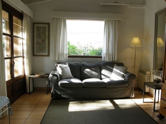 Ca'n Quatre: Casita number 8, sofa and picture window