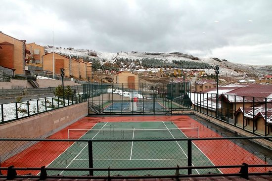 Tennis courts at the Tsaghkadzor Marriott Hotel. See ski slopes behind!