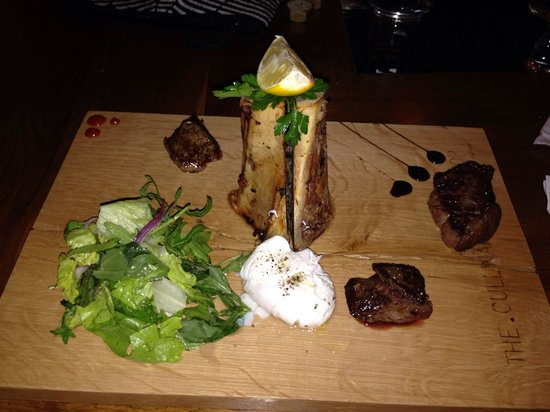 The Culinary Workshop: Meat entree and salad. Bone was cut open and filled with delicious marrow dish