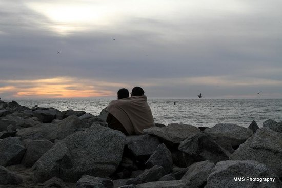 Moss Landing State Beach: Couple enjoying the sunset