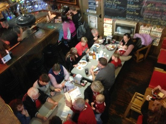Cooter Brown's Rib Shack: Two tables photographed from the upper level.  Booths at right.