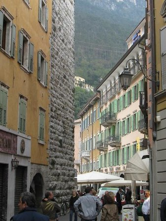 Centrale Hotel -- Riva Del Garda: from down the street back to the hotel and the cliff on the other side