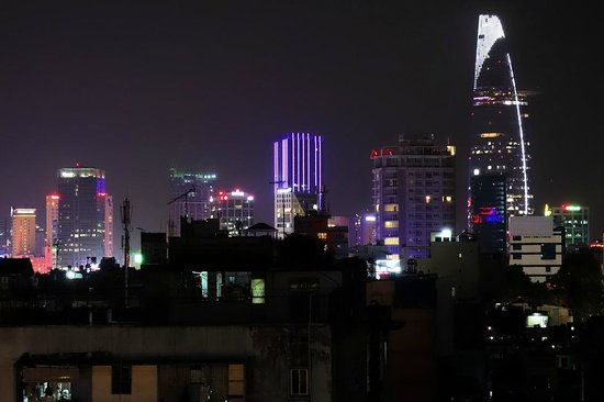 Duc Vuong Hotel : Rooftop night view with Bitexco tower in background