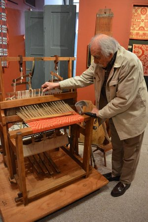 National Museum of the American Coverlet: Our tour guide demonstrating how this older style loom works
