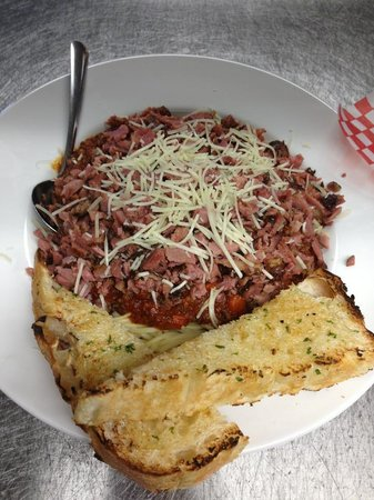 Dunn's Famous Bank Street Deli: Spaghetti Caruso. Homemade sauce, topped with smoked meat and served with a side of garlic bread