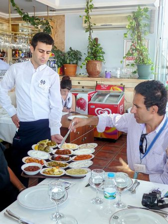 Istanbul Custom Tours-Private Day Tours : Aykut explaining the appetizers we've ordered.