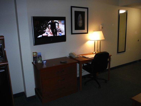 Sleep Inn & Suites Port Charlotte : Television set and desk in the room.