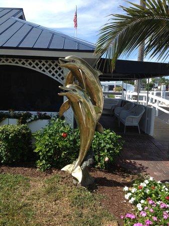 Gramma Dot's Seaside Saloon : Brass dolphins outside Gramma Dot's
