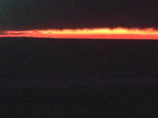 Herring Cove Beach: nov 10,2013 ... sunset on a rainy day. dark on shore, clear on horizon
