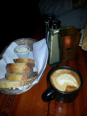 Petite Provence : Fresh bread w/Rosemary butter & a cafe latte.  Yum