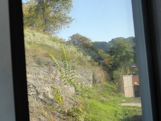 Super 8 Pittsburgh/Monroeville: View of cliff out of room window at back of hotel.