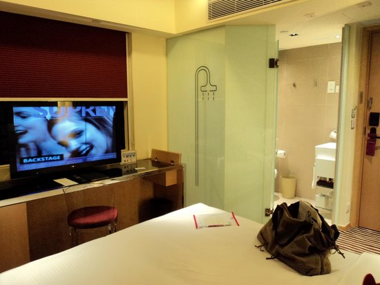 Butterfly on Victoria: View from other side of the room - TV, bed, shower & toilet