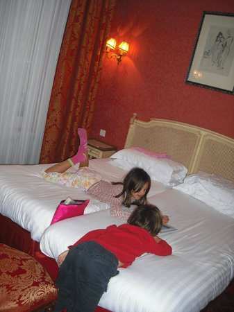 Hôtel de Seine : My kids in our triple room.  My (twin) bed is on other side of room