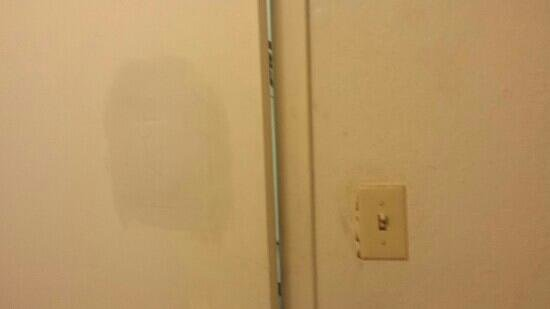 Quality Inn & Suites: huge hole in the bathroom door...