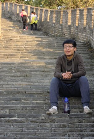 Beijing One-day Private Tour Guide Ryan Chao: Ryan @ the Steps of the Great Wall - with glasses. What a Geek !! LOL