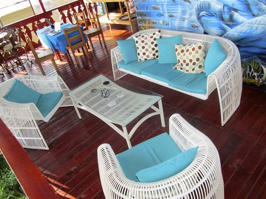Blue Dolphin Guesthouse: Our lounge and dining areas overlook the beautiful Caribbean Sea.