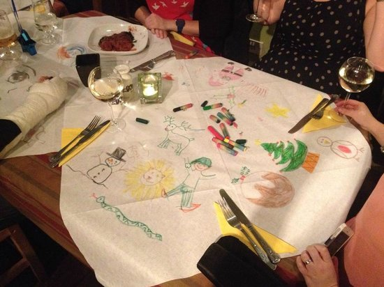 Amigos Mexican Restaurant & Steakhouse: drawings on tablecloths with crayons to entertain us whilst waiting for food :)