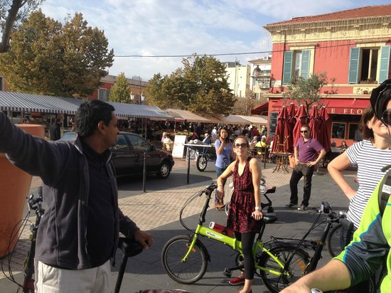 Nice Cycle Tours : Tour guide, Al, giving us a history of the architectural styles used in Nice throughout the year