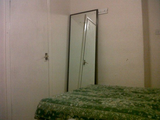 Commercial Hotel : Mirror perched against the wall and if accidentally knocked over cause injury.