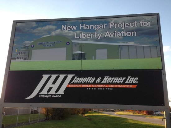 Liberty Aviation Museum: A sign of our new hangar that is now being constructed by Janotta & Herner!!!!