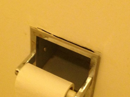 Guest Inn : TP role holder - barely hanging on ! For God's sake, fix this junk!