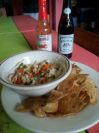 Meldy's: fantastic ceviche ... warm chips...cold beer