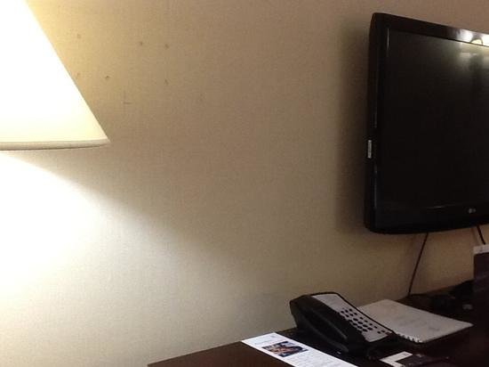 "Sheraton Fort Worth Downtown Hotel : view showing location of ""plugged"" holes in wall. maybe the tv was moved?"