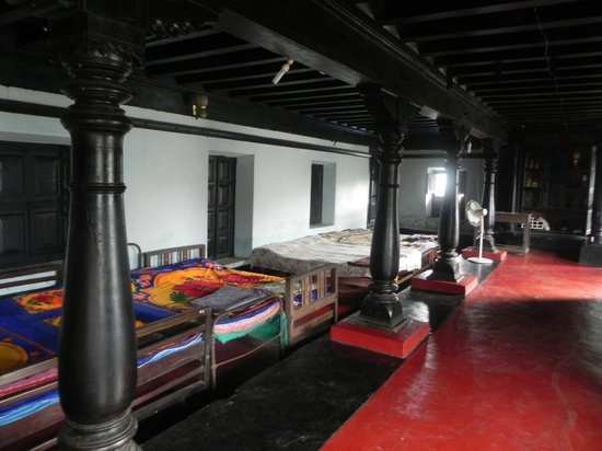Dodda Mane: Old style interiors of the bed room in the attic
