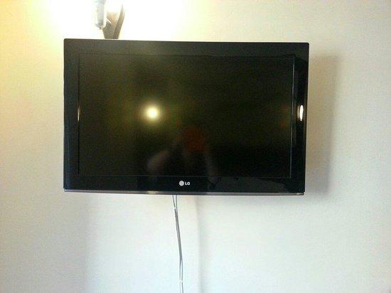Kn Columbus Aparthotel : La tv a pagamento