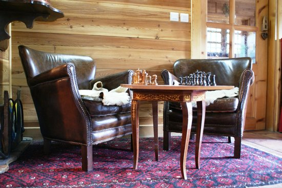 Antique furniture and decoration throughout the ski chalet ...