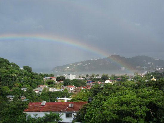 Buena Onda Backpackers : Double rainbow from the upstairs. Church steeple is yellow and visible to the right.
