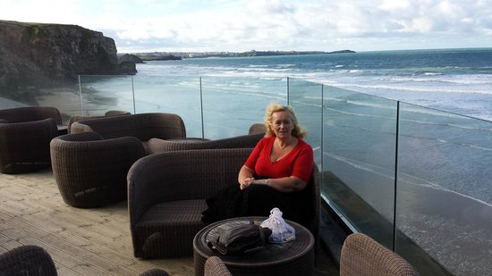 Watergate Bay Hotel: Outdoor lounge area and view across Watergate Bay