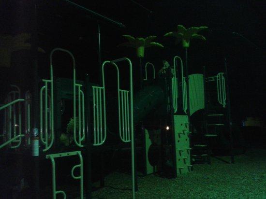 Liki Tiki Village: playground area at night.