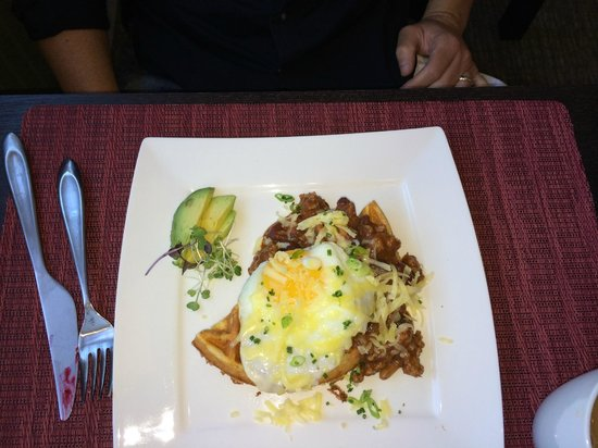 Olea Hotel: spiced corn waffle with sausage and bean chili with an egg on top