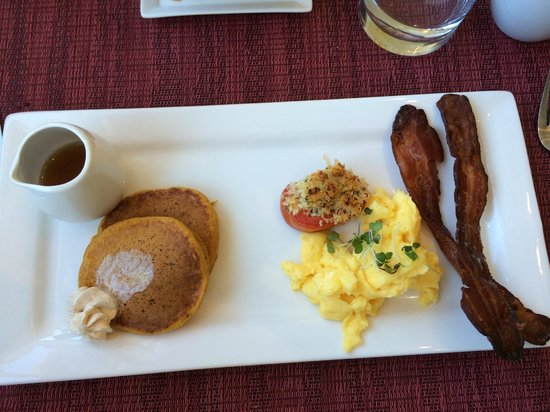 Olea Hotel: pumpkin pancakes with orange cinnamon butter, eggs, roasted tomato and bacon