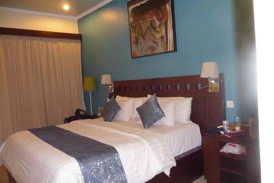 Lumbung Sari Cottages: Zimmer Doppelbett