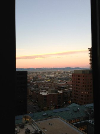 The Westin Denver Downtown: sunrise view of Rockies and stadium from bedroom