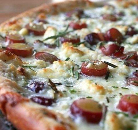 Porto: 'Grape N Gorg,' pizza  with red grapes, mozarella, provolone, gorgonzola cheese, sausage.