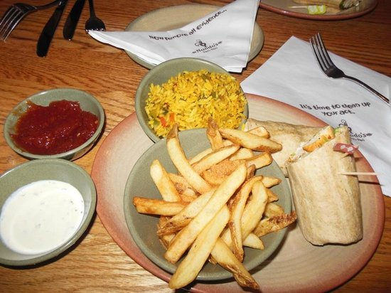 Nando's wrap with chips and spicy rice