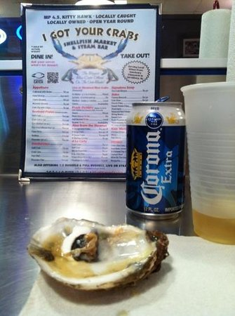 I Got Your Crabs Shellfish Market and Oyster Bar: still life with Corona can...