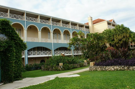 Manor house building at sandals grande riviera resort for Building a house in jamaica