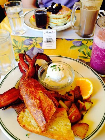 Mama's on Washington Square : Blueberry pancakes. Poached eggs with bacon, grilled potatoes and sourdough bread. Berry smoothi