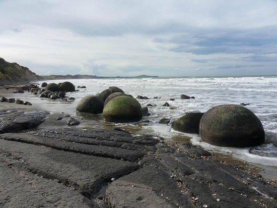 Round Rocks On Beach South Island Nz