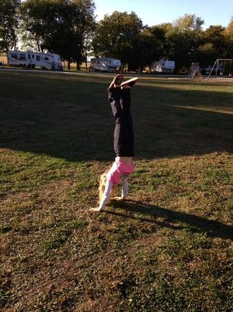 Topeka, IL : My daughter doing a handstand in one of the large fields.