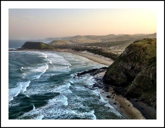 """Coffee Shack Backpackers : """"Sundowners"""" from atop the craggy-rocked coastline, view at Coffee Bay"""