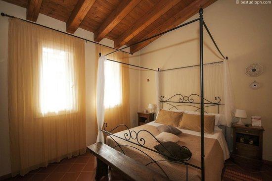 Bed and Breakfast All'Antico Brolo: Camera matrimoniale Melograno