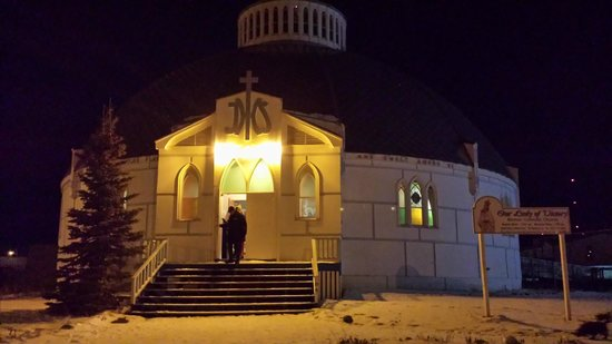 Igloo Church exterior at night.