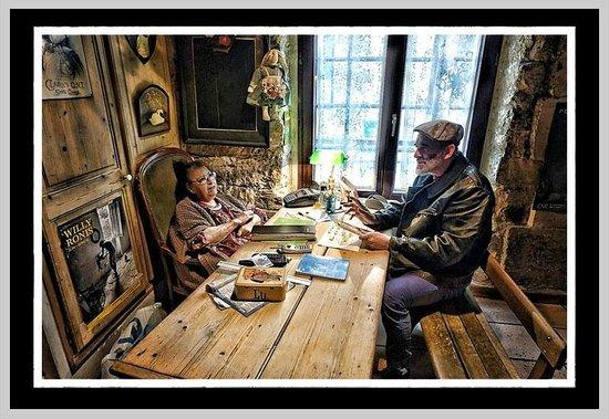 "Hotel de Nesle : Madam with a friend at ""reception desk"" as you enter."
