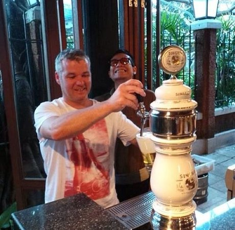 Jim Thompson Restaurant and Wine Bar: Wanting to pour his beer!